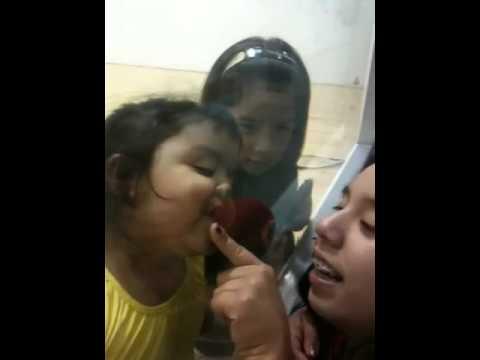 Kissing little girl