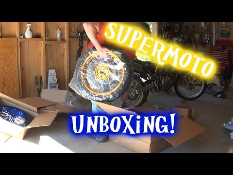 Suzuki Dr650 supermoto wheels unboxing