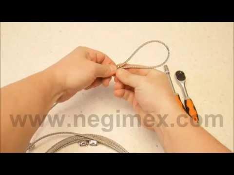 Negimex - pose de serre-câble sur un filin de suspension inox
