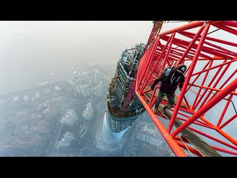 Breathtaking video: Daredevils skywalk world's 2nd-tallest tower in Shanghai