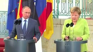 Merkel, Putin tackle tough topics in meeting outside Berlin