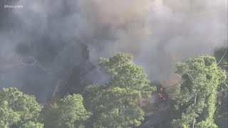 Two people burned in massive house fire in The Woodlands