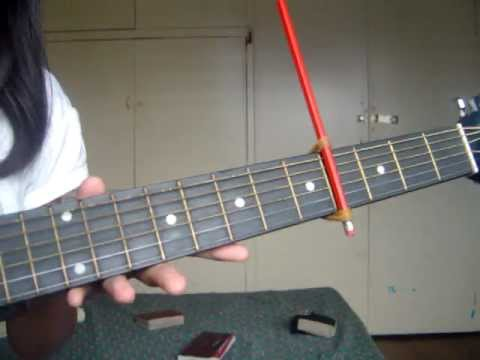 Make A Capo For Your Guitar With A Pencil And Some Rubber Bands