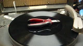 Repair of a model AE4 tube talking book record player from 1968