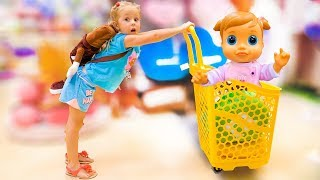 Nastya and baby doll doing shopping - song for kids Nursery Rhyme by Nastya at the candy shop