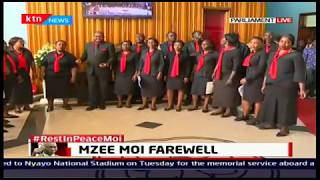 Kenyans flock in one by one to view the body of mzee Moi as they get entertained by parliament choir