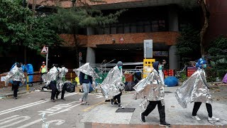 video: Hong Kong protests: Hundreds still trapped in university siege raising fears of crackdown