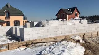 Construction of a residential two-storey brick house.