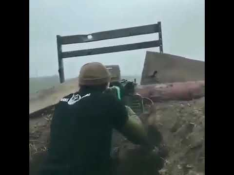 Ukrainian soldiers fending off Russian militants with HARD BASS playing in the background