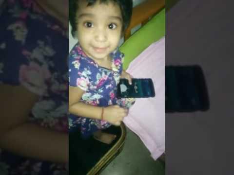 1 year daughter catching pokemon in pokemon-go game