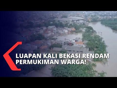 ratusan rumah di teluk pucung terendam banjir hingga meter