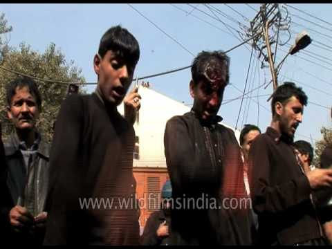 Shia Muslim Makes A Cut On The Forehead Of A Child During Muharram Procession Mp3