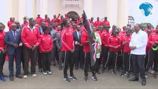 Uhuru hands over the national flag to Team Kenya