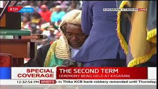 President Uhuru Kenyatta appends his signature during the inauguration ceremony