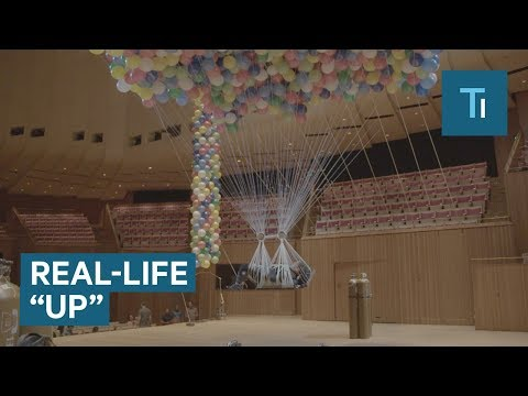 Daring Artist Suspended by Balloons Inside the Sydney Opera House