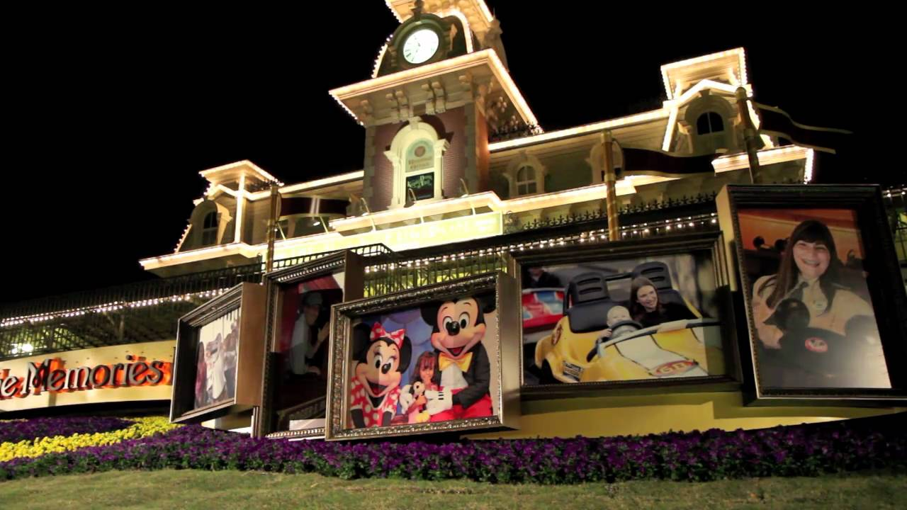 """Let the Memories Begin!"" - Magic Kingdom entrance decor"