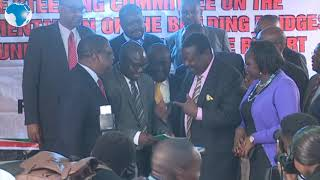 Mudavadi shares a light moment with the BBI team at KICC