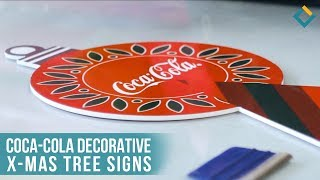 Coca-Cola decorative x-mas tree signs.