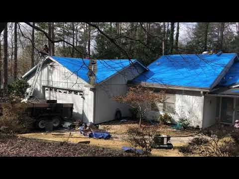 Here we have removed the old roof shingles. Installed new ice and water shield in the valleys and low slope area over the front porch. Installed the new blue synthetic underlayment and black drip edge. This will keep all the bad weather out for years. And we are ready for the new shingles.