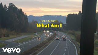 Musik-Video-Miniaturansicht zu What Am I Songtext von Lola Marsh