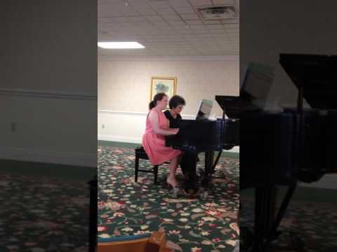 Julia and her teacher enjoy making music together