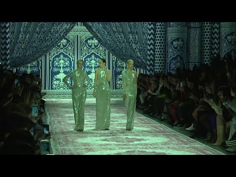 Naeem Khan has brought '70s glam back to the runway with the help of a few models of the time. The Halston icons Pat Cleveland, Karen Bjornson and Alva Chinn closed Khan's fashion show in silver sequined evening gowns.  Khan is known for his sparkling evening looks, but he got his start at Halston back in the day. (Feb. 12)