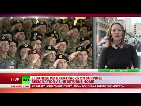 On Hold: Lebanese PM backtracks on surprise resignation as he returns home