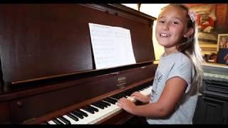 Brielle playing The Ballad of Davy Crockett
