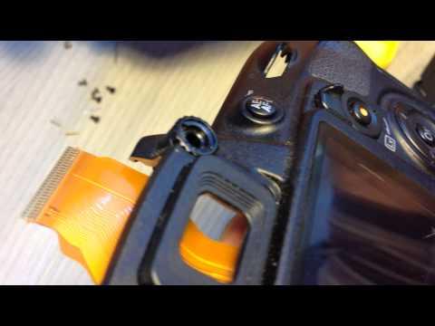 Nikon D3100 : разборка и ремонт. Потайные винты.