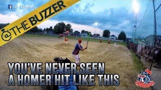 Softball player hits crazy backwards home run
