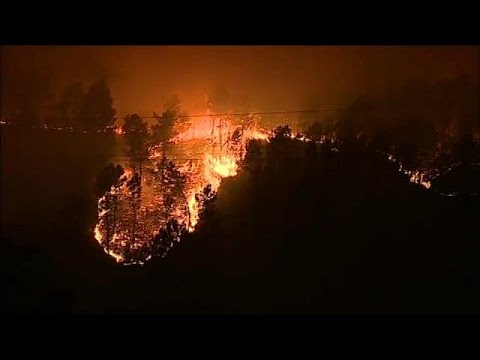 'Over 30 dead' as wildfires rage in Portugal and Spain