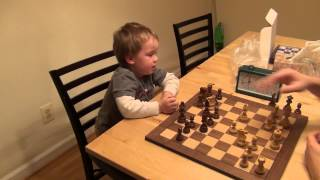 3 years old boy playing chess
