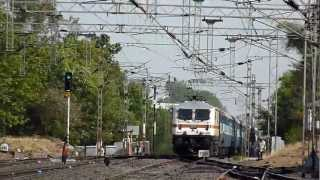 preview picture of video 'Twin WAG-9 silently watches the action of two LGD WAP-7's hauling Dakshin and KSK Express!!'