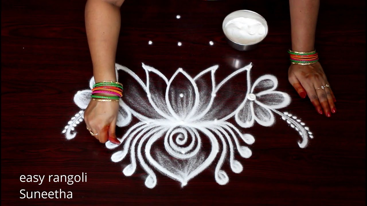 traditional rangoli design lotus flower by suneetha