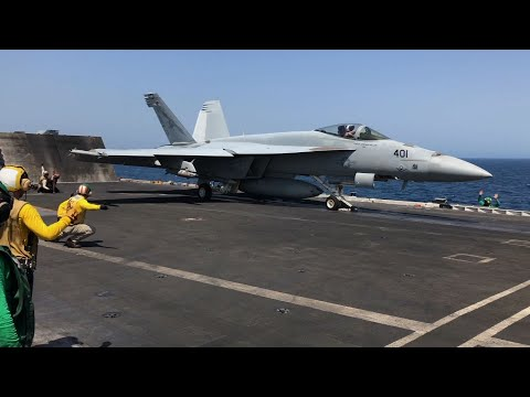 United States Navy fighter jets were flying missions from an aircraft carrier in the Arabian Sea on Saturday, a signal to Iran of America's global military reach. (June 8)