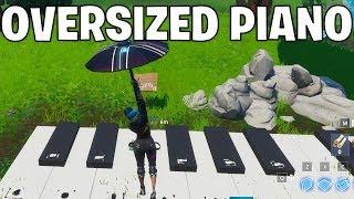 Visit An Oversized Piano - Fortnite season 10 week 6