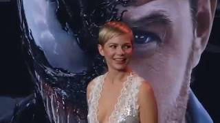 Michelle Williams wears a spectacular dress and her short hair also