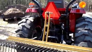 Tractor With Pine Needle Rake from Everything Attachments