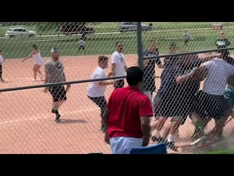 Police in Lakewood, Colorado have released video showing adults in a fight at a recent youth baseball game. A police spokesman says the fight was sparked because coaches and parents were angry with the 13-year-old umpire. (June 20)