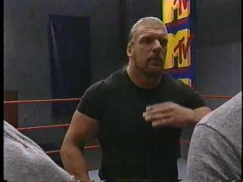 Triple H shows the difference between an Amateur and Pro Wrestler, then gives them all a little perspective.