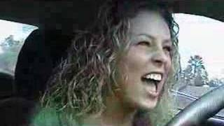 Amber Whitworth singing in her car commercial.