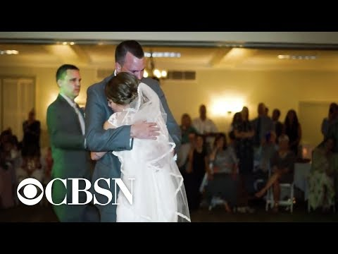 Bride's 5 brothers fill in for late father during wedding