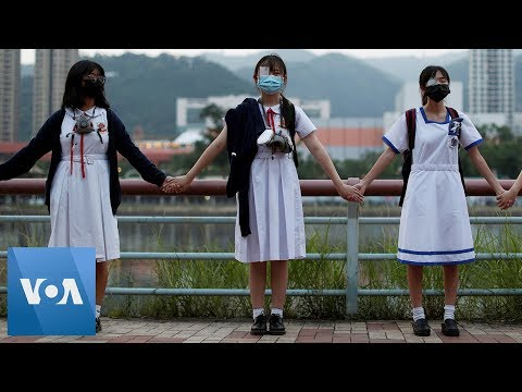 Hong Kong School Children Form Human Chain To Support Protests