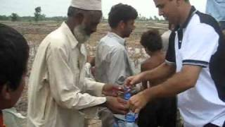 preview picture of video 'Rotary Club Rawalpindi  helping Flood affected people.wmv'