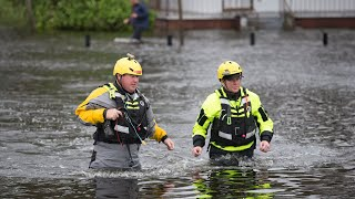 National Guard and firefighters conduct welfare checks after Hurricane Florence