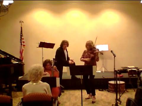 Stephanie Plays fiddle music.
