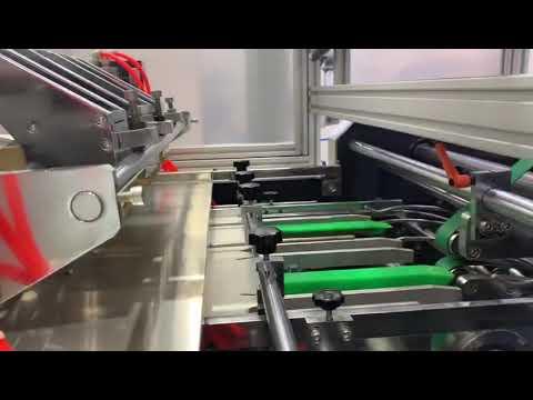 AUTOMATIC CARTON ERECTING MACHINE