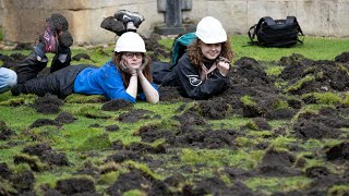 video: Climate change protesters dig up Trinity College lawn at Cambridge