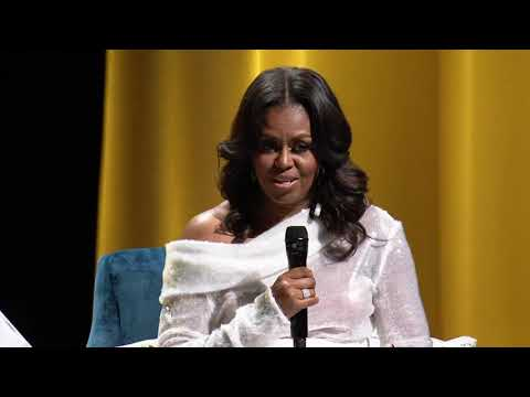 Michelle Obama began her 12-stop book tour Tuesday by sitting with Oprah Winfrey before a sold-out audience at the home arena of the Chicago Bulls and telling her about life in the White House. (Nov. 14)