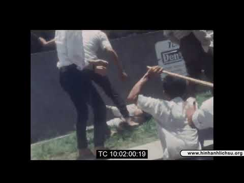 2 Frenchmen assaulted by the crowd in Saigon after they climbed on top of the south VN marines statue and flew the VC flag.